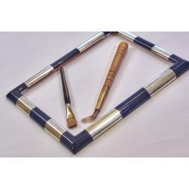 cornice artigiana argentata in foglia con inserti laccati blu